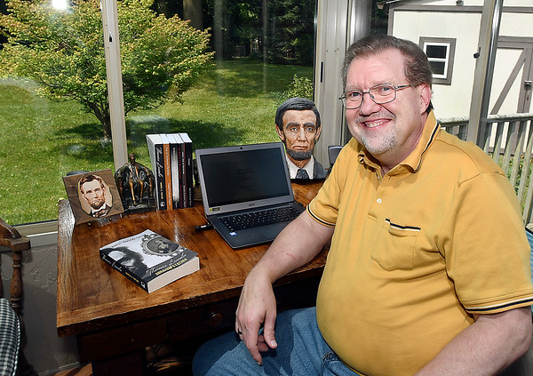 John P. Cleary | The Herald Bulletin<br /> Dan Taylor has written a biography on Thomas Lincoln, Abe Lincoln's father, which is being released July 26th. Taylor does most of his writing at his small desk in the sunroom of his house.