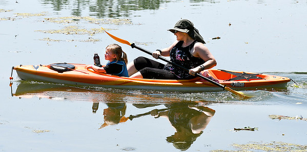 John P. Cleary | The Herald Bulletin<br /> Cassandra Estle takes Leia Jugg, 3, a ride around Shadyside Lake Monday afternoon. With the warm temperatures, but lower humidity, Estle decided getting the kayaks out on the water with family and friends was a good way to spend a summer afternoon.