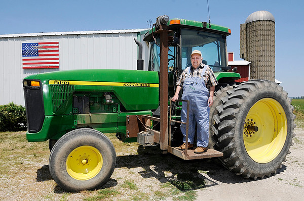 Don Knight | The Herald Bulletin<br /> Ralph Broyles, 92, had a lift added to his tractor so he could keep working his farm started by his father in Madison County.