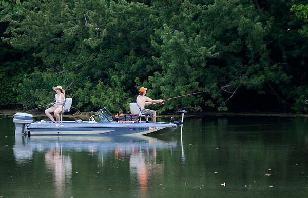 Don Knight | The Herald Bulletin<br /> Anglers try their luck after the heat of the day as a cold front approaches on Wednesday evening at Shadyside. The cold front passing overnight should bring some relief from the heat and humidity for the end of the work week.