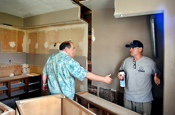 John P. Cleary | The Herald Bulletin<br /> Tim Perry, of Picket Fence of Anderson, talks with Jim Grueser, of Big Head Industry, on work that needs to be done to this unit being rehabbed.<br /> Both men are contractors working on the former Chase Apartments rehabilitation project.