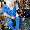 Don Knight | The Herald Bulletin<br /> Joe Green carves a walking stick in Grag Adams willow furniture shop during the Lapel Village Fair on Saturday. Green was selling his walking sticks leather goods and knives.