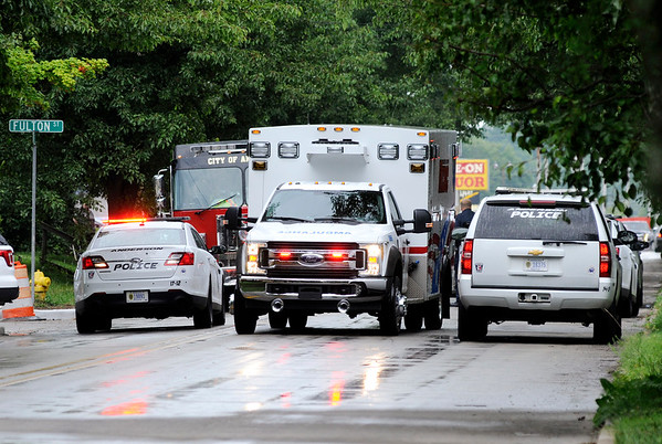 Don Knight | The Herald Bulletin<br /> AFD's Medic 3 carries a victim from a shooting on Nichol Avenue to St. Vincent on Saturday.
