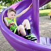 John P. Cleary | The Herald Bulletin<br /> Dax VanDuyn, 8, steadies himself as he comes down the spiral slide at Horne Park Tuesday. VanDuyn was enjoying the evening playing with friends at the 7th & John Street playground.
