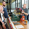 Don Knight | The Herald Bulletin<br /> Shamus Clark sells fireworks to Vaughn and Abby Rector on Friday. Clark was selling his remaining inventory at 50 percent off.