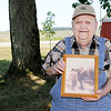 Don Knight | The Herald Bulletin<br /> Ralph J. Broyles holds a photo of him with his dad Ralph A. Broyles At 92 Broyles  is still working on the farm.