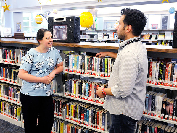 Don Knight | The Herald Bulletin<br /> Sarah Wallace, the new director of the Alexandria Public Library, talks to Youth Services Manager Brad Sowinski.