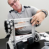 John P. Cleary | The Herald Bulletin<br /> Randy England, of Frankton High School, attaches a another piece to the frame as he assembles a VEX robot during robotics training at Purdue Polytechnic Tuesday.