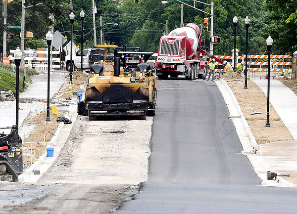 John P. Cleary | The Herald Bulletin<br /> Crews have been paving the stretch of College Dr. between 5th Street and University Blvd. Monday and Tuesday where new sewers, storm drains, curbs and sidewalks have been put in.
