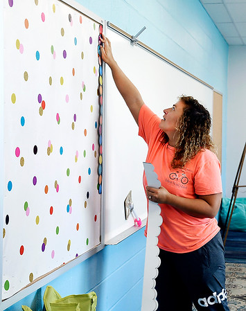 John P. Cleary | The Herald Bulletin<br /> Fifth grade teacher Madison Jansen decorates her bulletin boards in her new classroom at  Anderson Intermediate School.