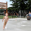 Don Knight | The Herald Bulletin<br /> Shane Chapman, 5, runs through the fountains of water at the Millcreek Sprayground behind the Millcreek Civic Center in Chesterfield on Thursday. The new splash pad is open from 10 a.m. to 9 p.m. and is outfitted with a motion sensor that keeps the pumps from running when no one is using the park. Clerk-Treasurer Deborah Dunham said upgrades to the park include new ADA compliant playground equipment was financed with taxes collected from Hoosier Park.