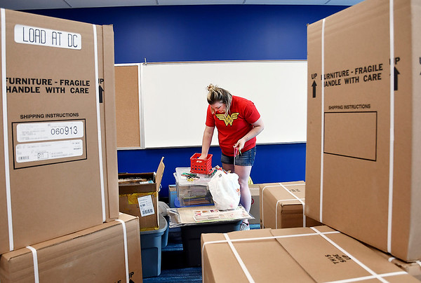 John P. Cleary | The Herald Bulletin<br /> Among the boxes of new desks waiting to be opened, first-year teacher Jessica Driscoll unpacks her things in her new classroom at Anderson Intermediate School. Driscoll will be teaching fifth grade this year.