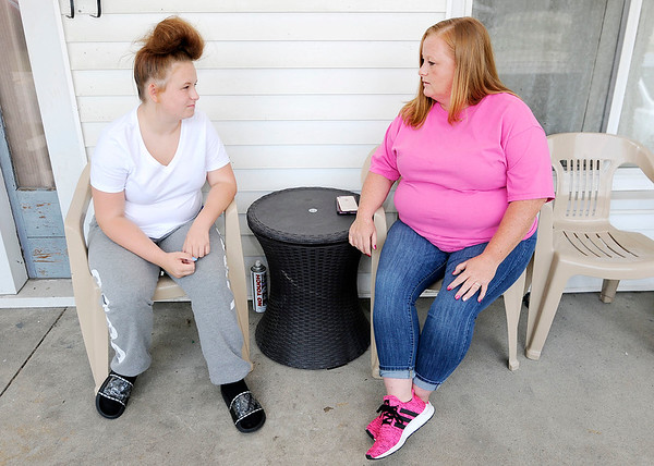 Don Knight | The Herald Bulletin<br /> Angela Heichel and her daughter Myka at the family home where Myka was assaulted. The attack was filmed and posted on Facebook.