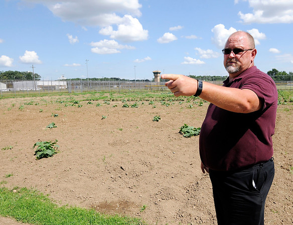 Don Knight | The Herald Bulletin<br /> Program Director Dale Fleming talks about the garden program at the Pendleton Correctional Industrial Facility.