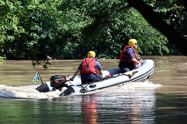 John P. Cleary | The Herald Bulletin<br /> Anderson Fire Department water rescue unit travels upstream on White River between Raible and Madison Ave Thursday morning searching for a 15 year-old kayaker.