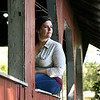 John P. Cleary | The Herald Bulletin  <br /> Kendra Penn looks out over Shadyside Lake and the area where she searched for her stepfather, Timothy Adkins, who went missing last year in June.
