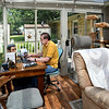 John P. Cleary | The Herald Bulletin<br /> Dan Taylor does most of his writing at his small desk in the sunroom of his house which he shares with the family cats.
