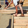 John P. Cleary | The Herald Bulletin<br /> Habitat for Humanity volunteer Mike Jones starts nailing 2x4 studs together to form a wall at the Habitat for Humanity construction site at 2804 Fairview Street in Anderson.
