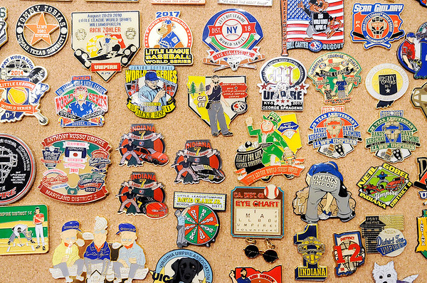 Don Knight | The Herald Bulletin<br /> Some of Don Mason's collection of umpire pins. Mason is working the Little League Softball World Series this year.