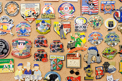 Don Knight | The Herald Bulletin Some of Don Mason's collection of umpire pins. Mason is working the Little League Softball World Series this year.