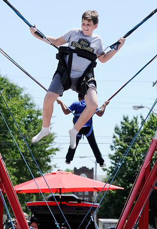 Don Knight | The Herald Bulletin<br /> Drew Hershberger tries the Bungee Jump at the Lapel Village Fair on Saturday.