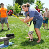 Don Knight | The Herald Bulletin<br /> Nova Gibson helps Nakota Nelson, 3, swing a hammer on a high striker carnival game set up for Daleville's Town Hall Independence Day celebration on Saturday.