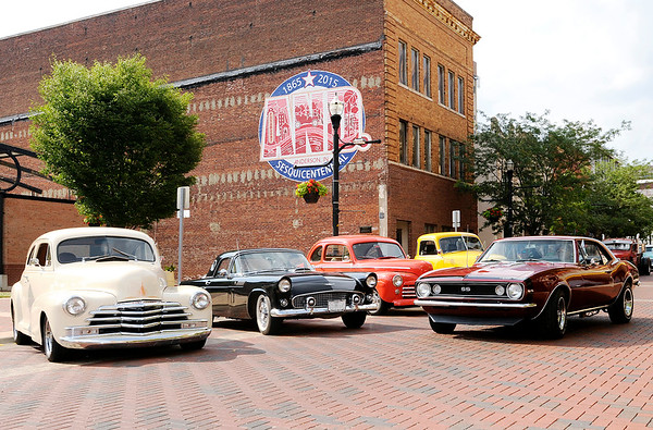 Don Knight | The Herald Bulletin<br /> Classic cars are lined up for the Tuesday Night Meridian Street Cruise-In at Dickmann Town Center. Weather permitting the weekly event hosted by Hoosier Street Rods and Classics Car Club of Central Indiana is scheduled through October starting at 5 p.m.