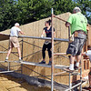 John P. Cleary | The Herald Bulletin<br /> Habitat for Humanity workers set up scaffolding around the outside of the house they are building at 2804 Fairview Street in Anderson for a single mother of three.