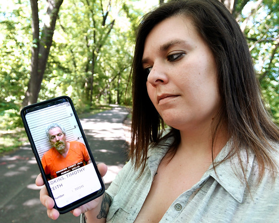 John P. Cleary | The Herald Bulletin  <br /> Kendra Penn holds a photo of her stepfather, Timothy Adkins, who went missing last year in June. They found him about a month after they reported him missing in jail in Dearborn County.