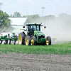 Don Knight | The Herald Bulletin<br /> A farmer fertilizes corn in a field behind Eastside Elementary School on Thursday.