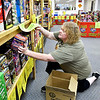 Carol Cox, owner of BC Fireworks in Chesterfield, restocks the shelves Wednesday as their sales have been higher then normal this year for a  multitude of reasons including the coronavirus and the 4th falling on a weekend.