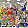 Carol Cox, owner of BC Fireworks in Chesterfield, brings out a special item for a customer Wednesday as fireworks sales have been higher then normal this year for a  multitude of reasons.