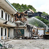 Davis Excavating started demolition of the former Economy Inn at Scatterfield and Mounds Road Monday morning. The vacant structure was on the City of Anderson's Blight Elimination project list to come down.