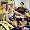 Tina Fields selects another item as her grandson, Eli Strong, looks on as they shop for fireworks at BC Fireworks in Chesterfield Wednesday afternoon. Fields, from Jonesboro, stopped to shop while in the area visiting friends.