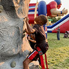 C.J. Wooden starts his ascent on a 36-foot climbing wall during Anderson's Independence Day Celebration on Saturday at Athletic Park.