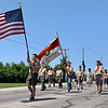 Members of Boy Scout Troop 230 of Chesterfield march in the town's annual Fourth of July parade Saturday.