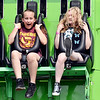 Aryanna Kennedy, 11, of Alexandria, and Kyle Newland, 15, of Elwood, react as they drop down from the top of the ATMOS-FEAR ride Tuesday at the Madison County 4-H Fair.