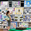 Jennifer Pearson, of Anderson, checks out the different projects that are on display in the 4-H Building exhibit hall during the fair.