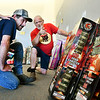 Lit Fireworks staff member Mark Kilbourne, right, explains the difference between these large packages of fireworks to customer Darrin Barrett as he shopped at the store at 1708 South Scatterfield Road in Anderson Friday afternoon.