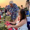 Anderson Mayor Tom Broderick chats with Shelley Huttenlocker during the city's Independence Day Celebration on Saturday evening at Athletic Park.