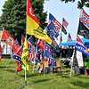 There are a variety of different flags that this vendor is displaying for sale at the Madison County 4-H Fair.
