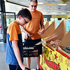 Brian Thompson checks with what his son, Micah, 11, has in his basket as they shop for fireworks at Lit Fireworks at 1708 South Scatterfield Road in Anderson Friday afternoon. The Thompsons are from Colorado and are in town for the holidays visiting family.<br /> <br /> <br /> <br /> <br /> Customers shopping at Lit Fireworks.