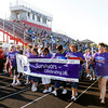 Cancer survivors walk a lap during the Relay for Life at Highland Junior High School on Friday.