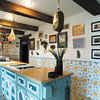 Desiring a French farmhouse look in the kitchen, Judy had Gentry Cabinets replicate cabinetry from a picture and installed old beams from a farmhouse in southern Indiana.