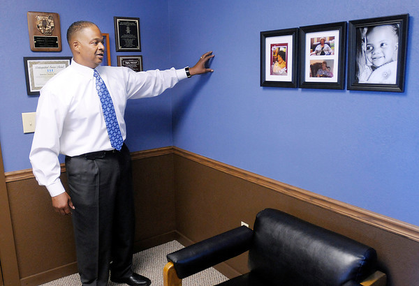 CATS Manager Stephon Blackwell stands in his office where drywall salvaged from the Edgewood Plaza has been installed. In an effort to save money and recycle the CATS offices are being remodeled using material salvaged from Edgewood Plaza which is scheduled for demolition.