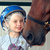 Hoosier Park and the Indiana Standardbred Assoc. hosted over 300 girl scouts and their families Friday for Family Night at Hoosier Park.  Gweneth Kortorax, 7, from Noblesville,  gets up close to Jet On Bye in the paddock area during Family Night at Hoosier Park.