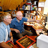 Co-authors of The Gospel  Trumpet Years book, Dale Stultz and Douglas Welch, work in Stultz's study in the loft of his home.