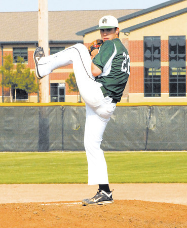 Pendleton Heights starting pitcher Mitch Patishall goes into his wind up from the mound.