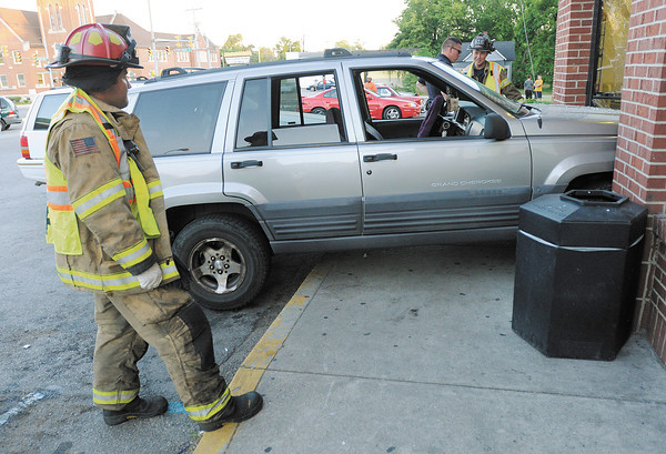 Anderson's police and fire departments responded to a Jeep Grand Cherokee crashed into the front door of the Village Pantry at 8th and Madison on Thursday.