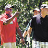 Saint John's Children's Clinic Classic celebrity player Stew Robinson points to his teammates Phil Birkla and Mile Wren after making his birdie putt on ninth hole during the annual golf tournament Tuesday.